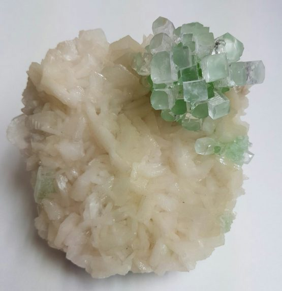 Elegant specimen of Apophyllite on Stilbite matrix with interesting green contrast.