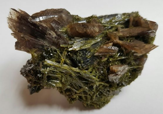 Axinite crystal group covered by Epidote crystals.
