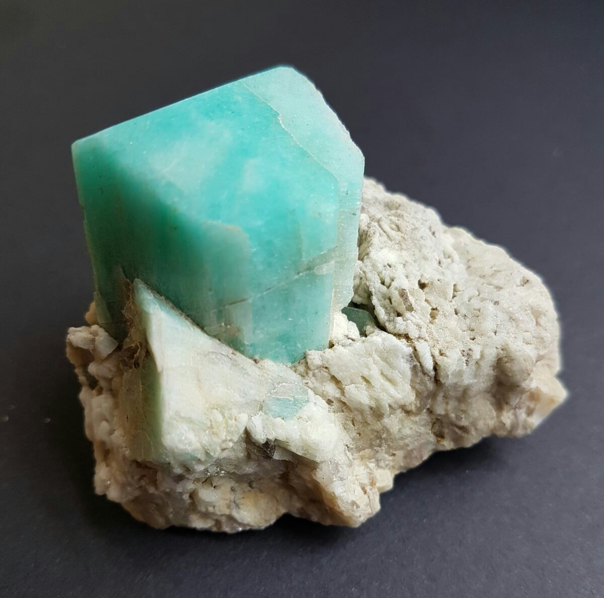 Amazonite crystal on matrix, with vertical crystal of magnificent green color.
