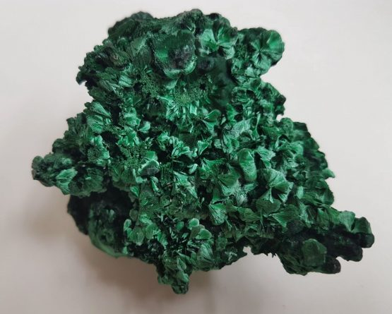Aggregate of Malachite crystals, fan-shaped radiating and fibrous.