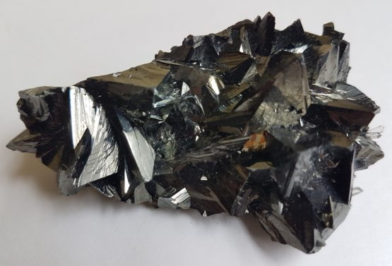 Very shiny and sharp Tetrahedrite crystals with some small crystals of Quartz.