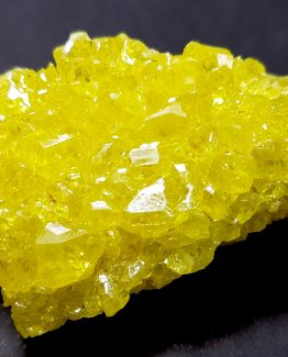 Sulfur small-crystal aggregate of intense yellow color and great luster.