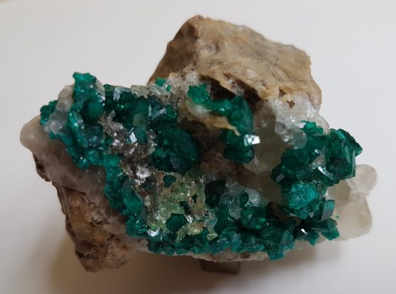Dioptase and calcite crystals combination on matrix.
