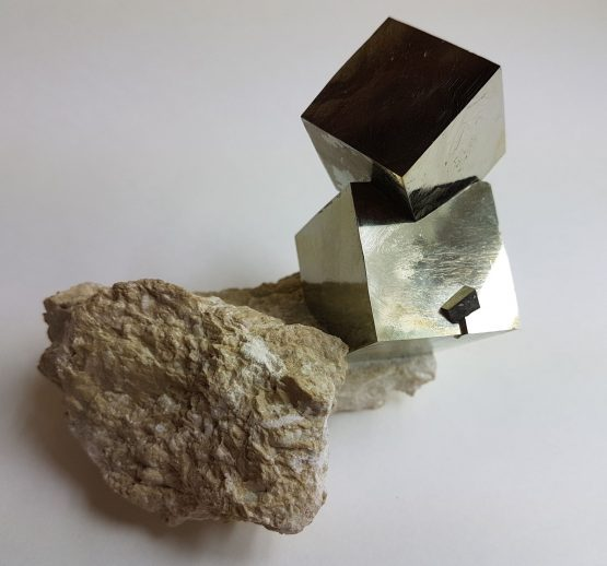Twinned Pyrite group on matrix.