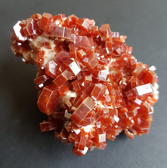 Hexagonal Vanadinite crystals on a white Baryte matrix.