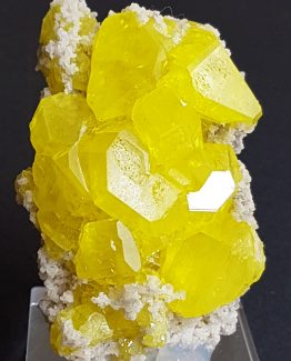 Elegant cluster of gemmy to translucent Sulfur with Calcite crystals.