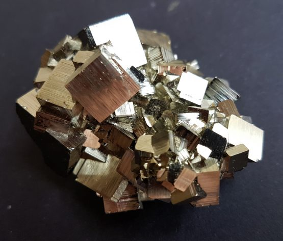 Group of striated cubic Pyrite crystals.