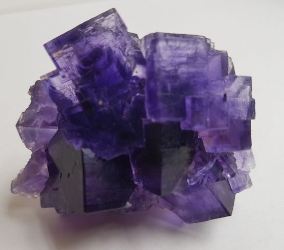 Aggregate of violet Fluorite cubic crystals.