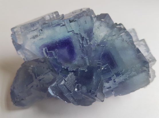 Violet-blue cubic crystals of Fluorite with purple phantoms.