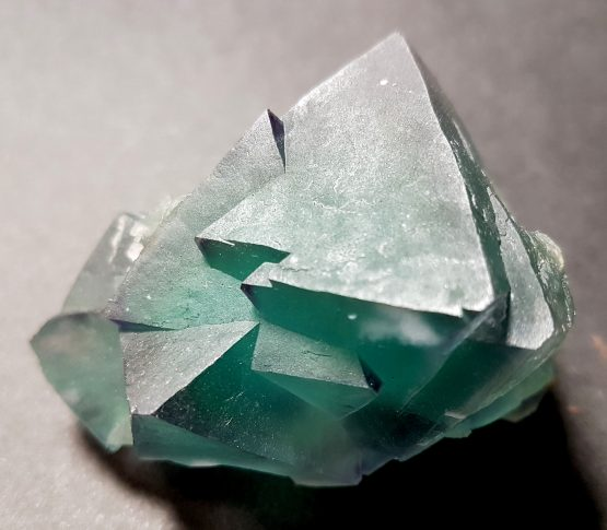 Group of  twinned octahedral crystals of green Fluorite