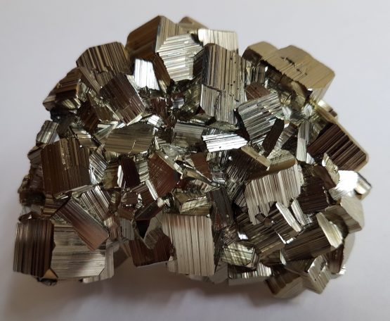 Floateer group of cubic and striated Pyrite crystals.