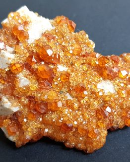 Group of well-defined small Spessartine Garnet crystals