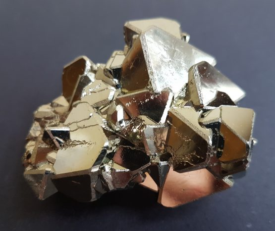 Dense group of bevelled octahedral Pyrite crystals.