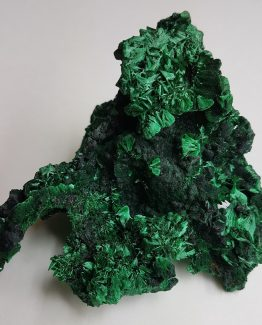 Specimen of Malachite with fan-shape fibrous radiated crystals areas.