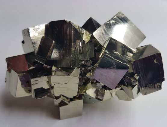 Set of twinned cubic crystals of Pyrite, with perfectly defined faces and edges  and excellent brightness.