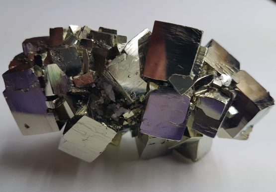 Set of twinned cubic crystals of Pyrite.