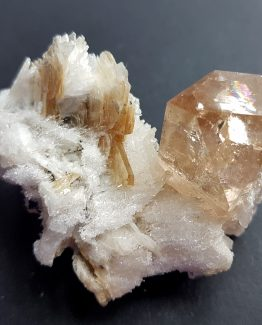 Terminated crystal of Topaz on Clevelandite and Muscovite matrix.