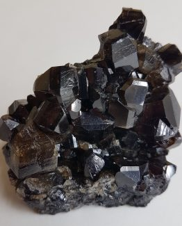 Cluster of twinned Cassiterite crystals.