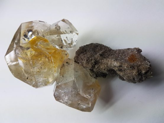 Group of three doubly terminated crystals of Herkimer Quartz.