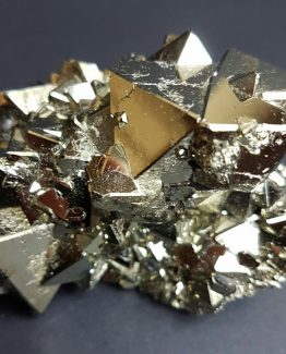 Group of twinned octahedral Pyrite crystals, with beveled faces.