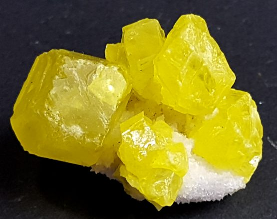Attractive group of Sulfur crystals and small crystals of white Calcite