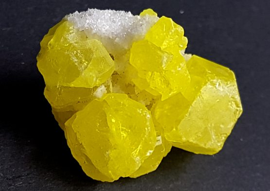 Group of Sulfur crystals and small crystals of white Calcite