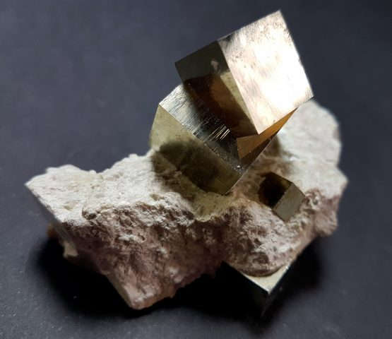 Beautiful cubic crystals of Pyrite on matrix.