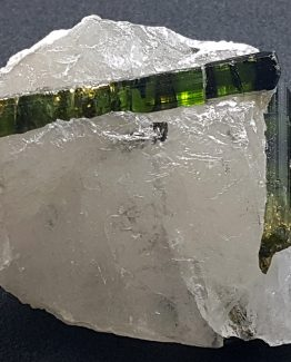 Verdelite Tourmaline crystals on a matrix of white Quartz.