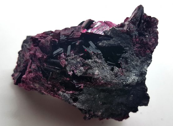 Terminated crystals of Erythrite on a matrix of metal sulphides