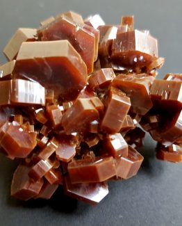 Vanadinite from Morocco with hexagonal crystals and intense color.