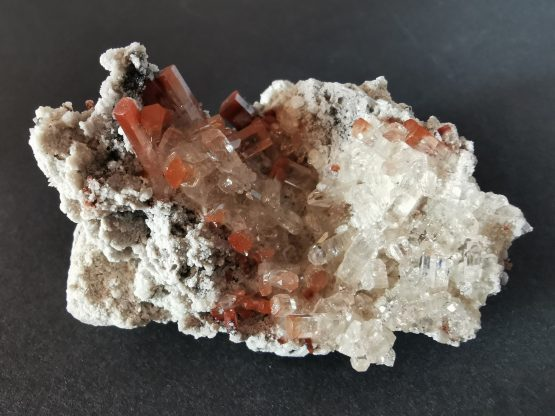 A group of small Topaz crystals on Rhyolite matrix